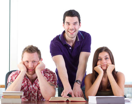 small group of people: Friends look bored of studying, one is still happy