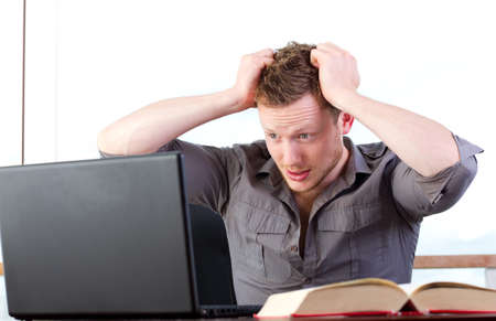 Student tears his hair out, stressed computer user