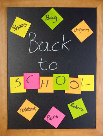 first day of school: Chalk blackboard with a fun back to school message and shopping list Stock Photo
