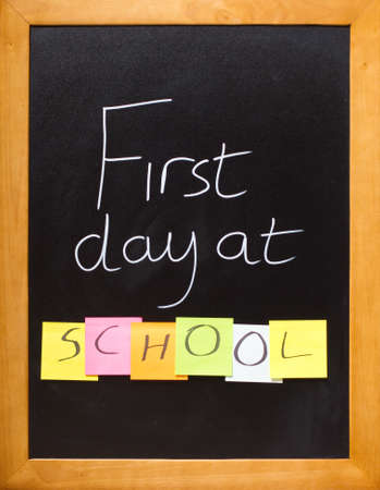 Blackboard showing a fun first day at school message Stock Photo - 12040191