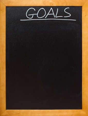 education goals: Goals in chalk on a blamk blackboard, lots of copyspace - add your own font