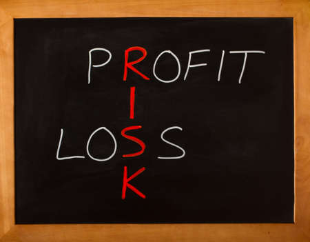 Risk, profit and loss business concept on a blackboard photo