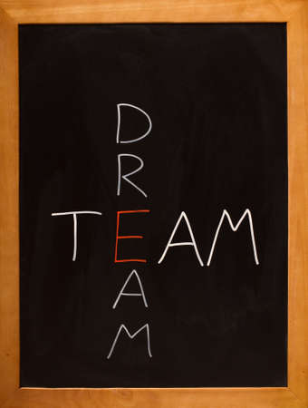 Chalkboard with the words dream team intersecting photo