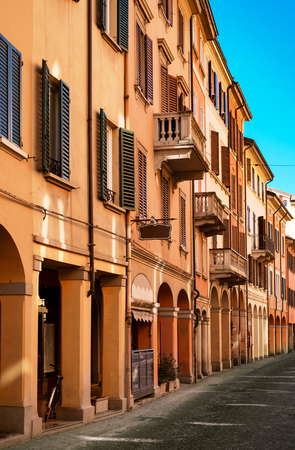 porch scene: kinds of portico in downtown Bologna. Emilia-Romagna, Italy.
