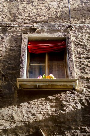 light  house: romantic window on historic palace in downtown Bologna