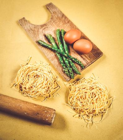 Tagliatelle, eggs and asparagus, mediterranean diet ingredients