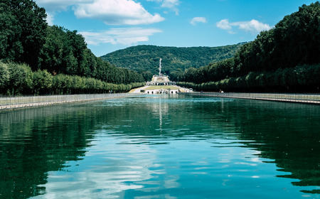 Caserta, Italy - 24 August 2016 - The gardens, the fountains and the long promenade of The Royal Palace of Caserta (italian: Reggia di Caserta)
