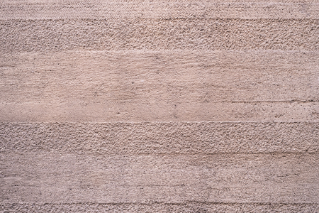 Textured concrete wall surface
