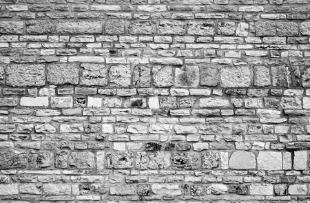 Stones and bricks mixed in a traditional wall construction of center Italy. Banco de Imagens