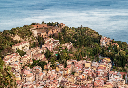 The ancient Greek theater above the village of Taormina, Messina province, Sicily, Italy. Mediterranean sea on background. Banco de Imagens