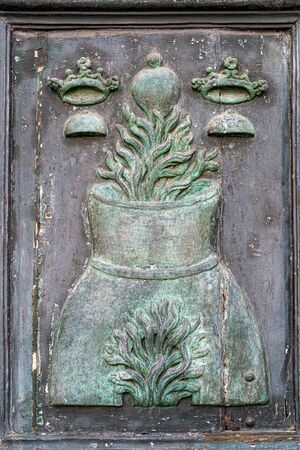 Sant'Agata Symbology on the main portal of the metropolitan cathedral of Catania.  Sculpted in wood covered in copper.