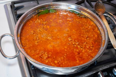 Cooking ragu at home.  -ragù is a meat sauce for pasta typical of  the  Emilia Romagna region, Italy.