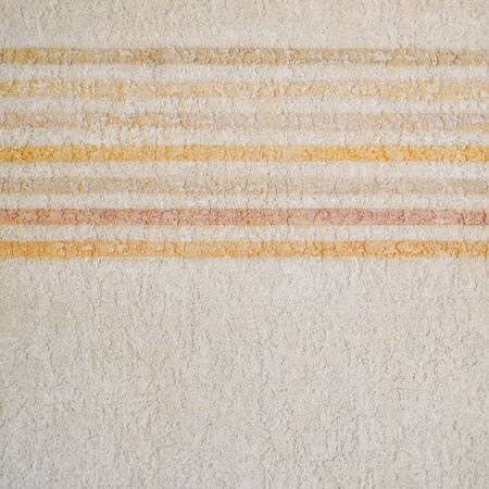 Warm pastel colors stripes painted on rough wall