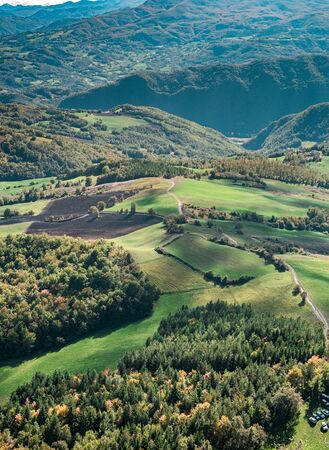 Bird's eye view on woodland and cultivated fields from the top of the Stone of Bismantova. Reggio Emilia province, Emilia Romagna, Italy.
