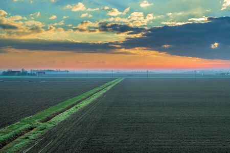 Winter sunrise in the lower Po Valley plain. Bologna province, Emilia Romagna, Italy.