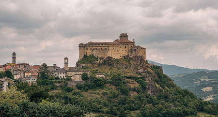 The castle and the village of Bardi in a cloudy day. Parma province, Emilia and Romagna, Italy.