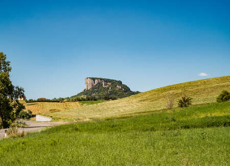 The Pietra di Bismantova (Stone of Bismantova) viewed from the ground.  Castelnovo ne' Monti, Reggio Emilia province, Emilia Romagna, Italy.