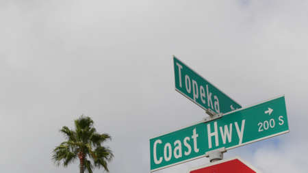 Pacific Coast Highway, historic route 101 road sign, tourist destination in California USA. Lettering on intersection signpost. Symbol of summertime travel along the ocean. All-American scenic hwy.