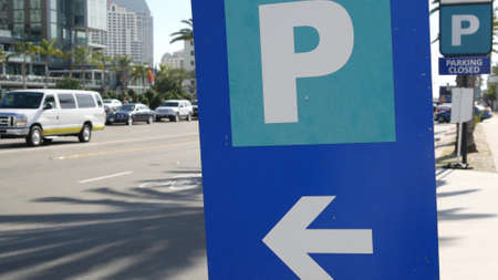 Parking lot sign as symbol of traffic difficulties and transportation issues in busy urban areas of USA. Public paid parking zone in downtown of San Diego, California. Limited space for cars in city. 写真素材