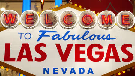Welcome to fabulous Las Vegas retro neon sign in gambling tourist resort, USA. Iconic vintage glowing banner, symbol of casino, games of chance, money playing and hazard bets. Illuminated signboard.