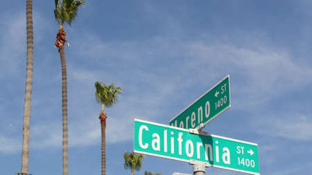 California street road sign on crossroad. Lettering on intersection signpost, symbol of summertime travel and vacations. USA tourist destination. Text on nameboard in city near Los Angeles, route 101.