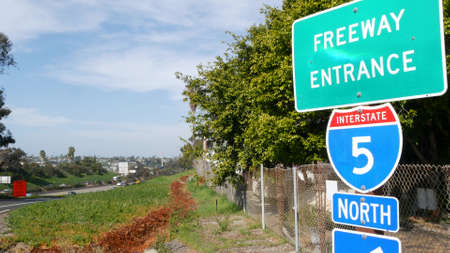 Freeway entrance, information sign on crossraod in USA. Route to Los Angeles, California. Interstate highway 5 signpost as symbol of road trip, transportation and traffic safety rules and regulations.