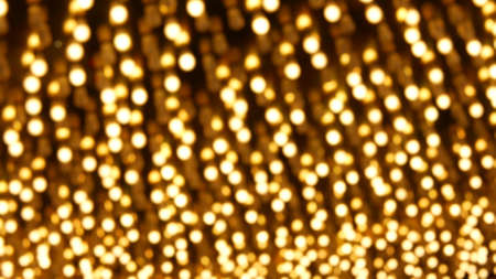 Defocused old fasioned electric lamps glowing at night. Abstract close up of blurred retro casino decoration shimmering, Las Vegas USA. Illuminated vintage style bulbs glittering on Freemont street. Banque d'images