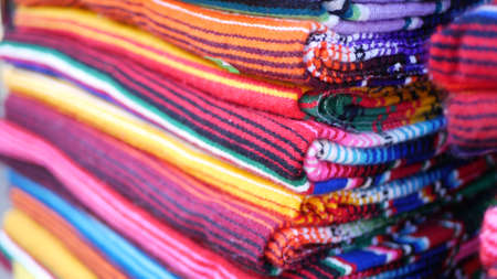 Colorful mexican wool serape blankets texture. Woven ornamental vivid textile with authentic latin american pattern. Striped multi colored fabric for poncho and sombrero. Hispanic indigenous style.