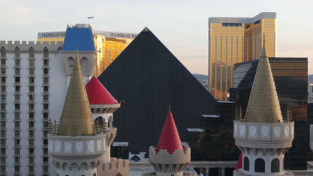 LAS VEGAS, NEVADA USA - 4 MAR 2020: Excalibur castle and Luxor pyramid casino uncommon aerial view. Plane flying from McCarran airport. Mandalay Bay and Delano hotel in american gambling sin city.