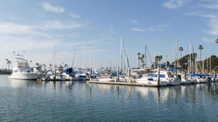 Oceanside, California USA - 27 Jan 2020: Waterfront harbor fisherman village, luxury yachts sailboats floating, marina harbor quay. Sail boat masts, nautical vessels anchored or moored in port. Standard-Bild - 158644878