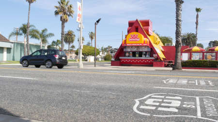 Oceanside, California USA - 20 Feb 2020: Wienerschnitzel hot dog fast food on pacific coast highway 1, historic route 101. Palm trees on street, road along ocean. Road trip vacations in united states. Standard-Bild - 158644876