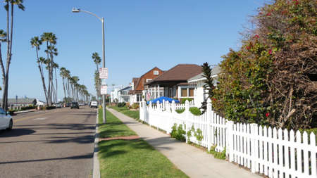Oceanside, California USA - 8 Feb 2020: Houses on suburban Pacific street. Generic buildings, residential district near Los Angeles. Real estate property exterior, typical american homes, palm trees.