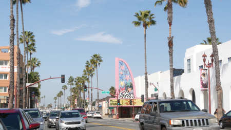 Oceanside, California USA - 20 Feb 2020: Authentic Star theater on pacific coast highway 1, historic route 101. Palm trees on street, road along ocean. Retro vintage signboard. City near Los Angeles.