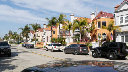 Oceanside, California USA - 27 Jan 2020: Typical suburban street. Different houses in row. Generic american homes, buildings facade, townhouse exterior architecture. Residential district real estate.