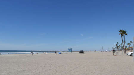 Oceanside, California USA -26 Feb 2020: American police department patrol car, squad, interceptor or cruiser, 911 auto, public safety vehicle. City near Los Angeles. Lifeguard tower, sandy ocean beach Editorial
