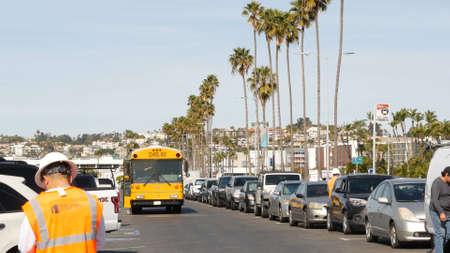 San Diego, California USA - Jan 31, 2020: American yellow school bus, street in downtown. Schoolbus shuttle on road, city near Los Angeles. Education transportation infrastructure. Standard-Bild - 158644906