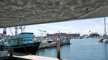 Oceanside, California USA - 26 Feb 2020: Harbor village with fisherman boats and yachts, pacific ocean coast marina, sea shore. Blue nautical vessel for fishing in port, fishery industry. Quay in bay. Standard-Bild - 158644909