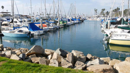 Oceanside, California USA - 27 Jan 2020: Waterfront harbor fisherman village, luxury yachts sailboats floating, marina harbor quay. Sail boat masts, nautical vessels anchored or moored in port. Standard-Bild - 158644910