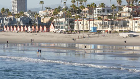 Oceanside, California USA - 11 Feb 2020: Local people walking strolling, pacific ocean coast, beach from pier. Sea water waves tide, shore sand. Beachfront vacations resort. Waterfront promenade. Standard-Bild - 159003930