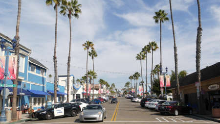 Oceanside, California USA - 27 Jan 2020: Police sheriff car, Pier View Coffee cafe. Palm trees on typical american street, pacific coast tropical resort. Auto transport on road, generic view of city. Editorial