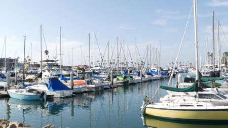 Oceanside, California USA - 27 Jan 2020: Waterfront harbor fisherman village, luxury yachts sailboats floating, marina harbor quay. Sail boat masts, nautical vessels anchored or moored in port. Standard-Bild - 159003938