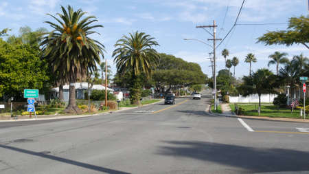 Oceanside, California USA - 27 Jan 2020: Houses on suburban street. Generic buildings, residential district near Los Angeles. Real estate property exterior. Tropical palms near typical american homes.