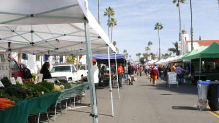 Oceanside, California USA -20 Feb 2020 People walking on marketplace, customers on farmers market. Buyers support business, vendors sell locally produced goods. Outdoor street trading stalls and tents Standard-Bild - 159003834