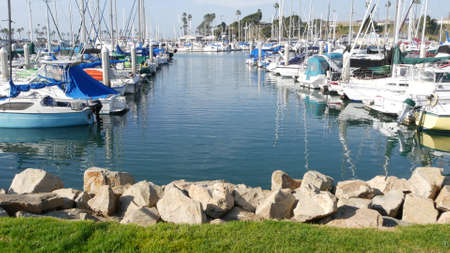 Oceanside, California USA - 27 Jan 2020: Waterfront harbor fisherman village, luxury yachts sailboats floating, marina harbor quay. Sail boat masts, nautical vessels anchored or moored in port. Standard-Bild - 159003839