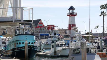 Oceanside, California USA - 26 Feb 2020: Harbor village with fisherman boats and yachts, pacific ocean coast marina, sea shore. Blue nautical vessel for fishing in port, fishery industry. Quay in bay. Standard-Bild - 159003838