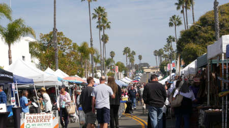 Oceanside, California USA -20 Feb 2020 People walking on marketplace, customer on farmers market. Vendors sell to byers locally produced goods. Street trading stalls and tents. We recycle plastic free Standard-Bild - 159003850