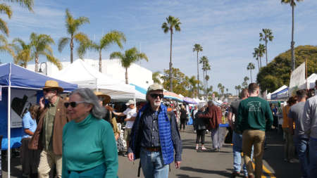 Oceanside, California USA -20 Feb 2020 People walking on marketplace, customers on farmers market. Buyers support business, vendors sell locally produced goods. Outdoor street trading stalls and tents Editorial