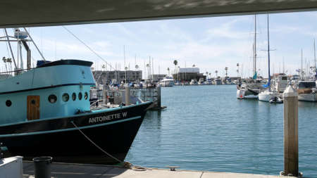 Oceanside, California USA - 26 Feb 2020: Harbor village with fisherman boats and yachts, pacific ocean coast marina, sea shore. Blue nautical vessel for fishing in port, fishery industry. Quay in bay. Standard-Bild - 159003862