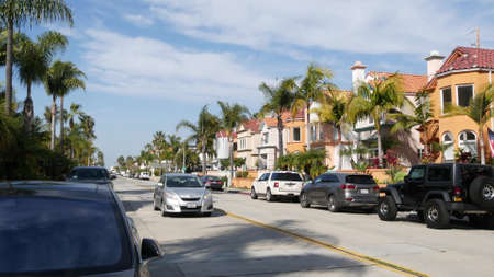 Oceanside, California USA - 27 Jan 2020: Typical suburban street. Different houses in row. Generic american homes, buildings facade, townhouse exterior architecture. Residential district real estate. Standard-Bild - 161603744