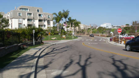 Oceanside, California USA - 27 Jan 2020: Palm trees on typical american street, pacific coast tropical resort. Auto transport on road, generic view of city. Sunny summer day in small town on route 101 Standard-Bild - 161603739